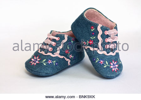 Baby shoes on white background - Stock Photo