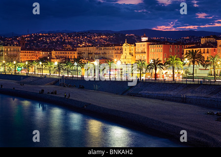 Evening at the beach front at Promenade des Anglais in Nice on the French Riviera (Cote d'Azur) - Stock Photo