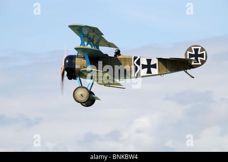 A World War 1 Fokker DR1 Triplane Replica In Flight. - Stock Photo