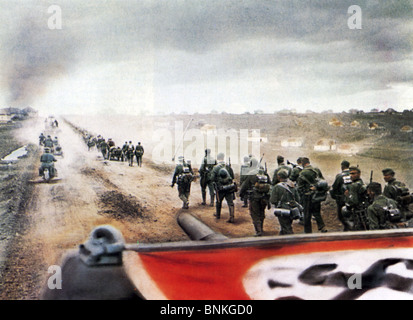 OPERATION BARBAROSSA  German infantry advance into Russia in 1941. Swastika serves as identifiction to their covering - Stock Photo