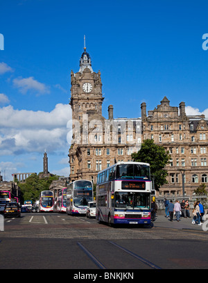 Lothian and First buses on Princes Street outside of Balmoral Hotel Edinburgh Scotland UK Europe - Stock Photo