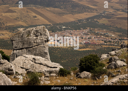 EL TORCAL MOUNTAIN RANGE NEAR ANTEQUERA SPAIN LOOKING DOWN ON A VILLAGE SURROUNDED BY OLIVE TREES IN GROVES - Stock Photo