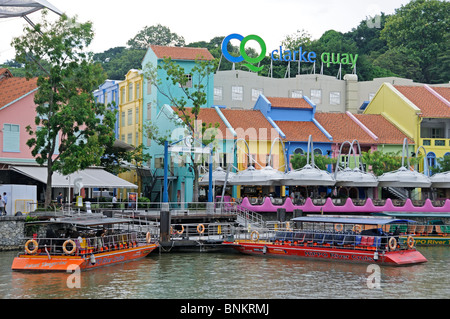 tourist boats on the Singapore River at Clarke Quay - Stock Photo