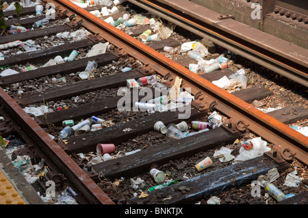 Litter on the subway tracks at an elevated station in the Sheepshead Bay neighborhood of Brooklyn in New York - Stock Photo
