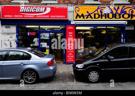 Shops in Brick Lane,  Tower Hamlets, London, England, UK - Stock Photo