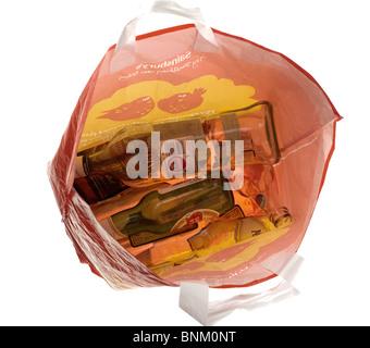 Orange bag full of empty bottles - Stock Photo