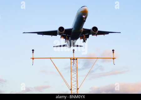 Boeing 777 operated by Jet Airways on approach for landing at London Heathrow Airport, UK. - Stock Photo