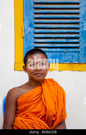 Portrait of a young, smiling novice monk in Cambodia - Kandal Province, Cambodia - Stock Photo