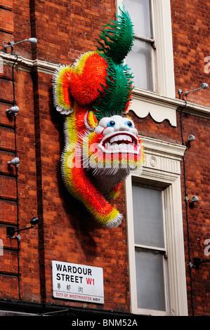Chinese Dragon wall decoration, Wardour Street, Chinatown, London, England, UK - Stock Photo
