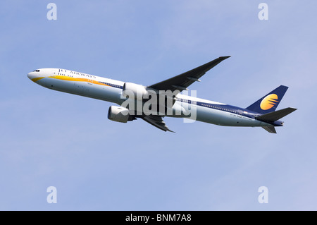 Boeing 777 operated by Jet Airways climbing out from take off at London Heathrow Airport, UK. - Stock Photo
