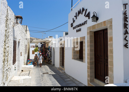 Shops and restaurant in the village of Lindos, Rhodes, Greece - Stock Photo