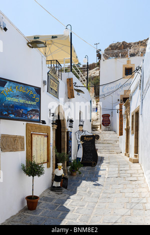 Restaurant in the village of Lindos, Rhodes, Greece - Stock Photo
