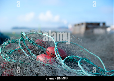 Fishing nets piled up in the harbor of Uusikaupunki, Finland - Stock Photo