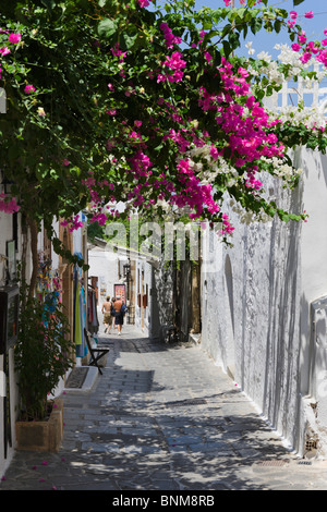 Typical street in the village of Lindos, Rhodes, Greece - Stock Photo