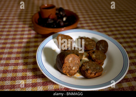 Blood sausage made from Spanish Iberian pigs sits on a plate in a home in Prado del Rey, Cadiz, Spain. - Stock Photo