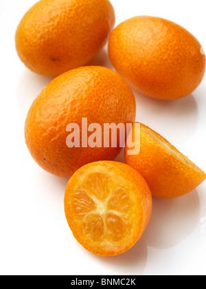 Fresh ripe kumquats on a white background - Stock Photo