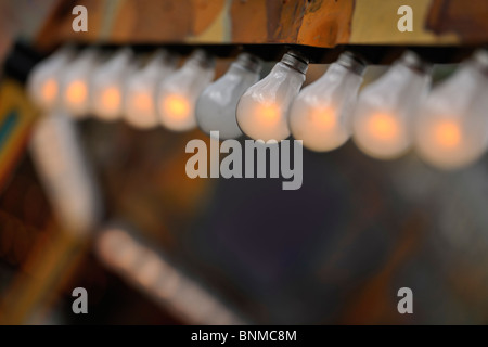 A row of electric light bulbs - Stock Photo