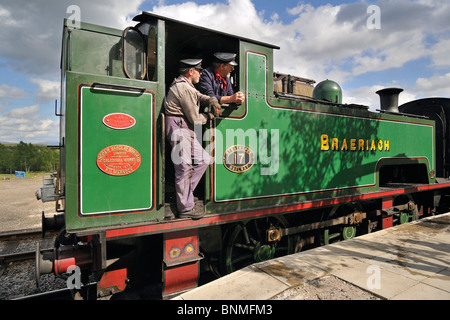 Engine drivers in steam engine / locomotive at the Boat of Garten railway station, Scotland, UK - Stock Photo