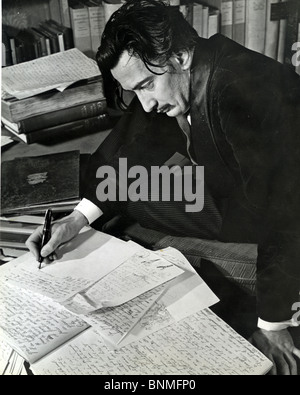 SALVADOR DALI  (1984-89) Spanish artist writing his autobiography in 1940. See Description below - Stock Photo
