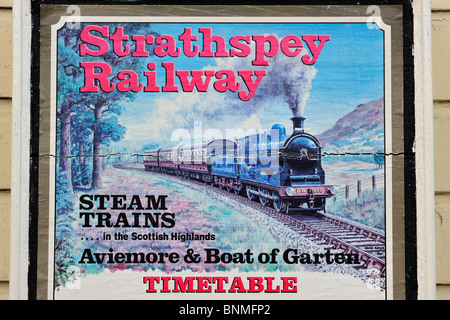 Strathspey Railway poster showing a steam engine / locomotive at the Boat of Garten railway station, Scotland, UK - Stock Photo