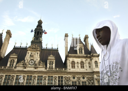 Young man in front of the city hall in Paris, France - Stock Photo