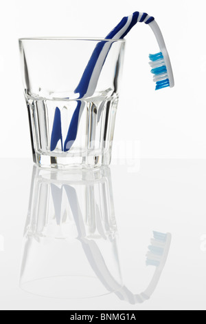 Toothbrush in Glass with Bad Breath - Stock Photo