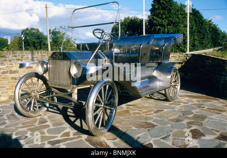 A full size Ford Model T  in stainless steel on a plinth at Ballinascart. Co Cork Ireland- birth place of Henry - Stock Photo