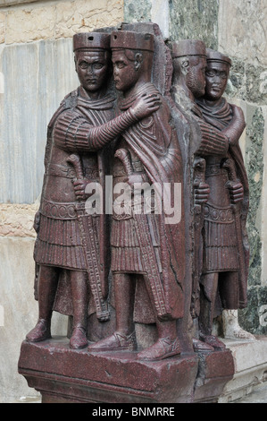 Venice. Italy. 4th C porphyry sculpture of the Tetrarchs on the exterior of St Marks Basilica. - Stock Photo