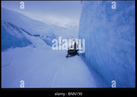Snowmobiling on icebergs near Portage Spencer Lake AK Southcentral winter scenic - Stock Photo