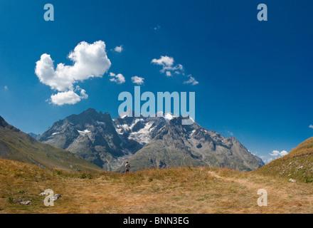 Col du Lautaret La Meije La Grave Hautes-Alpes France Landscape Field Meadow Summer Mountains Hills People France - Stock Photo