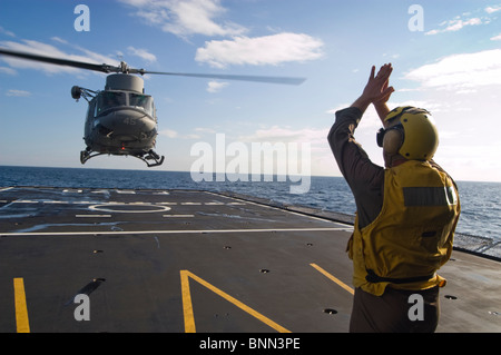 A  AB-212ASW  landing on the flight deck of the Italian Maestrale class frigate ITS Maestrale (F570) - Stock Photo
