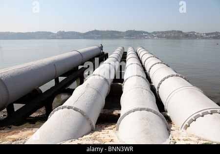 Sewage system over the river water - Stock Photo