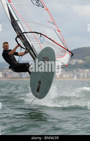windsurfer caught in mid flight in Swansea Bay, site of Tidal Lagoon - Stock Photo