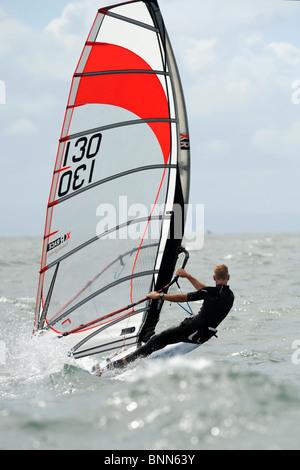 Course board   windsurfer racing at full tilt in Swansea Bay, site of Tidal Lagoon - Stock Photo