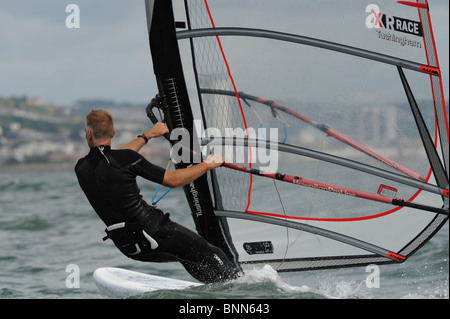 Course board   windsurfer racing at full tilt - Stock Photo