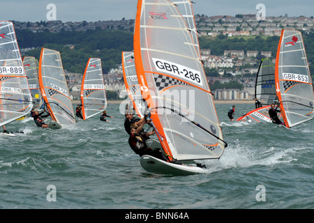 Windsurfers jostle for position at the start of a course race, Swansea Bay site of Tidal Lagoon - Stock Photo