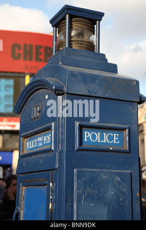 An old traditional blue police call box in Piccadilly Circus, London, W1. - Stock Photo