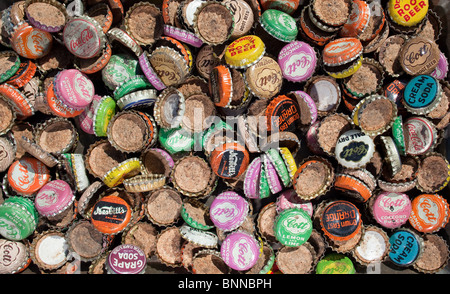 A collection of antique bottle caps. - Stock Photo