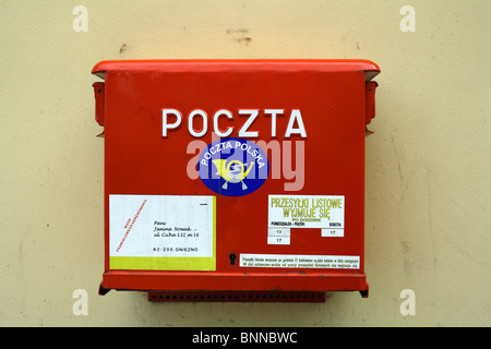 Red letter box of the Polish postal service (Poczta Polska), Poznan, Poland - Stock Photo