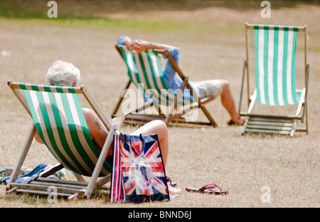 Deck chairs at St James park, London - Stock Photo
