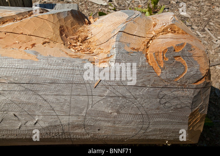 USA, Alaska, Kake -carving a totem pole - Stock Photo