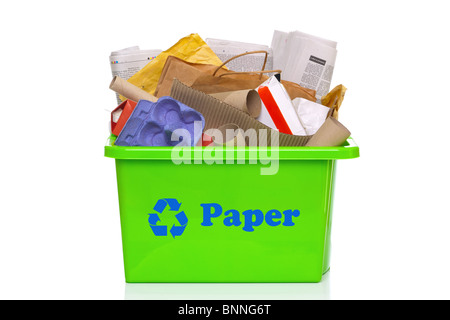 Photo of a green paper recycling bin isolated on a white background. - Stock Photo
