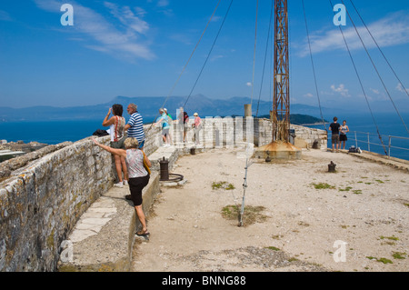 Tourists looking at the view from the old Venetian fortress in Corfu Town on the Greek island of Corfu Greece GR - Stock Photo
