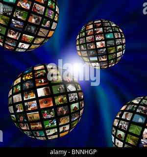 Four spheres of photographs or video in a blue vortex - Stock Photo