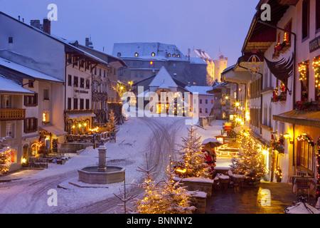 Gruyères FR Christmas lighting village Christmas Advent canton Fribourg Freiburg Switzerland lighting investigation - Stock Photo
