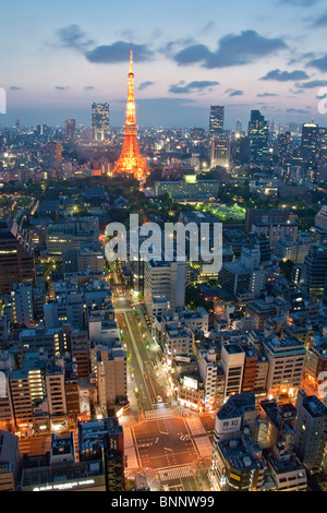 Japan Asia Far East Tokyo building construction Minato Ku Zojoji temple Tokyo Tower television tower night traveling - Stock Photo