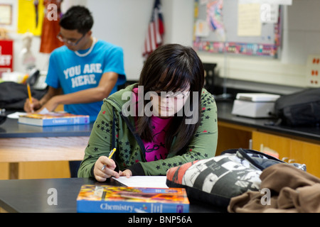 Anglo girl concentrates while taking chemistry test at Manor New Tech High School in Manor, Texas - Stock Photo