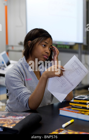 African-American girl concentrates while taking chemistry test at Manor New Tech High School in Manor, Texas - Stock Photo