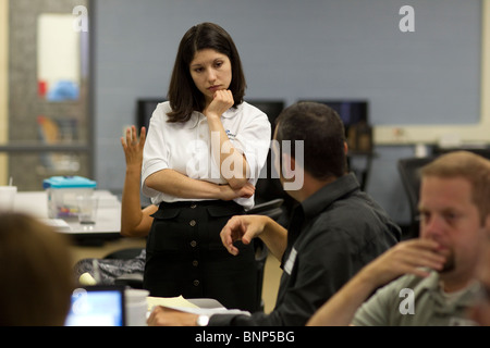 Hispanic female teacher listens to question during teacher training workshop at Manor New Tech High School in Manor, - Stock Photo