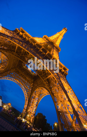 The Eiffel Tower at Night, Paris, France - Stock Photo